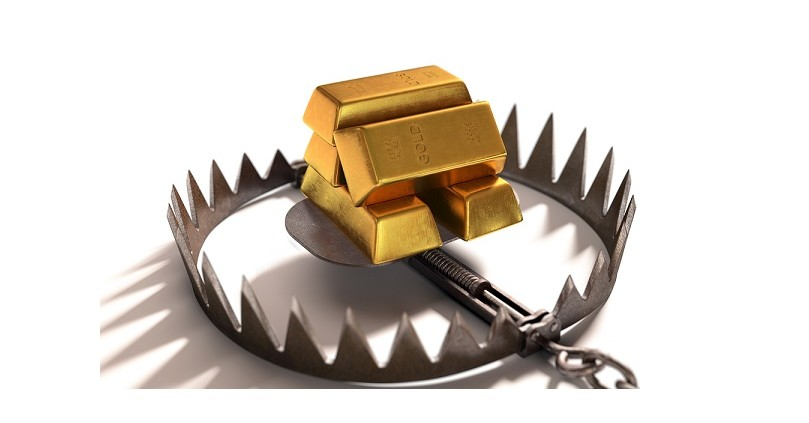 Bear trap with gold bars as bait on white background.